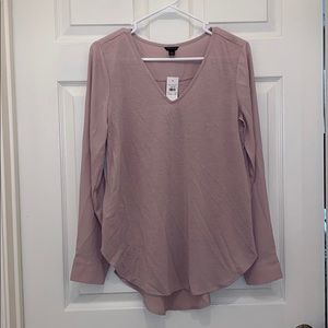 And Taylor curved hem long sleeve top